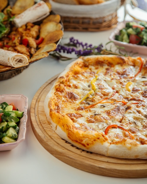 Thick pastry pizza with mushrooms Free Photo