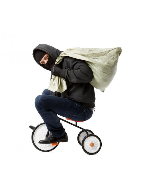 Thief goes on children's bicycle Premium Photo