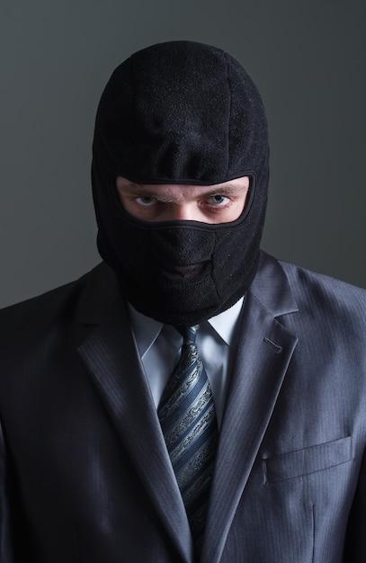 Вор в черной маске Premium Фотографии