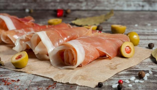 Thin slices of prosciutto Premium Photo