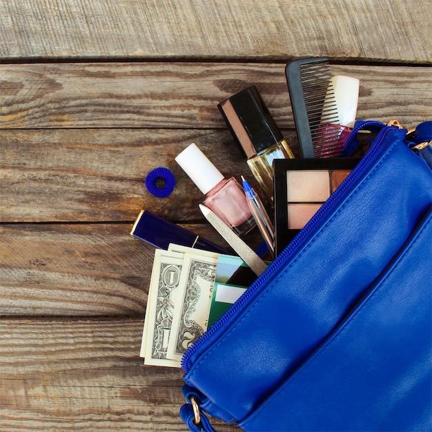 Things from open lady handbag. Premium Photo