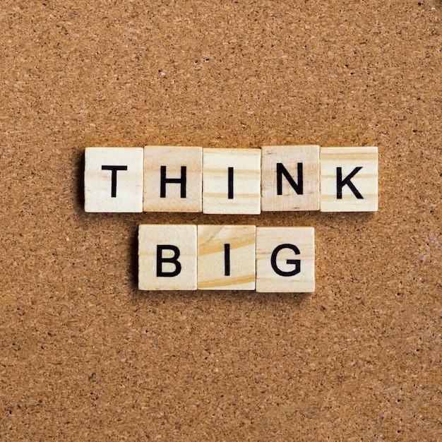 Think big quote written with scrabble letters Free Photo