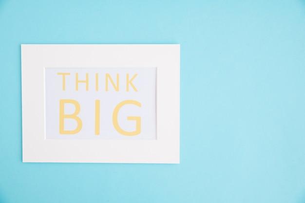 Think big text white frame on blue background Free Photo