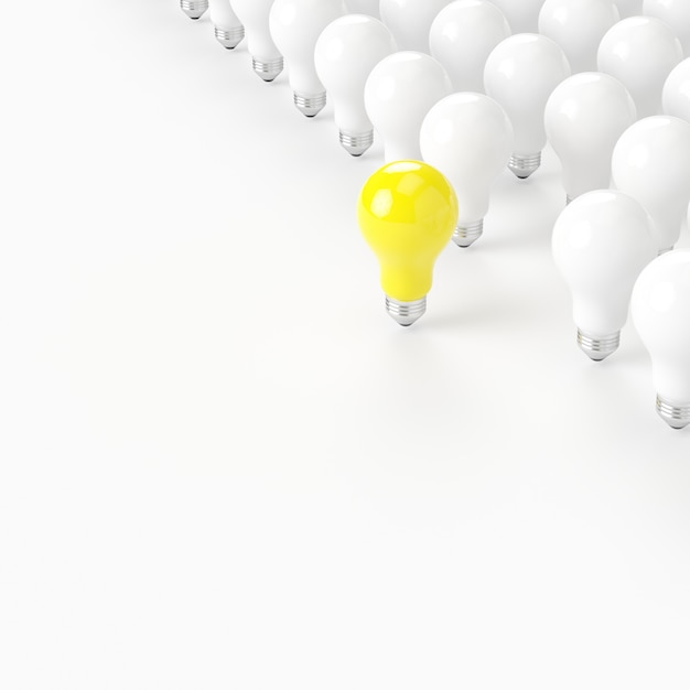 Think different. outstanding yellow light bulb with white light bulb on white background. minimal concept Premium Photo