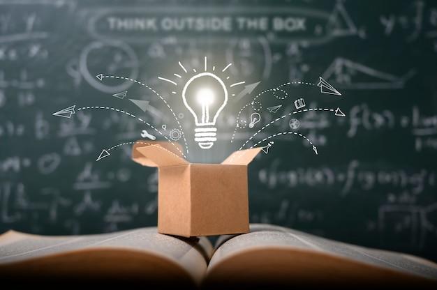 Think outside the box on school green blackboard Premium Photo