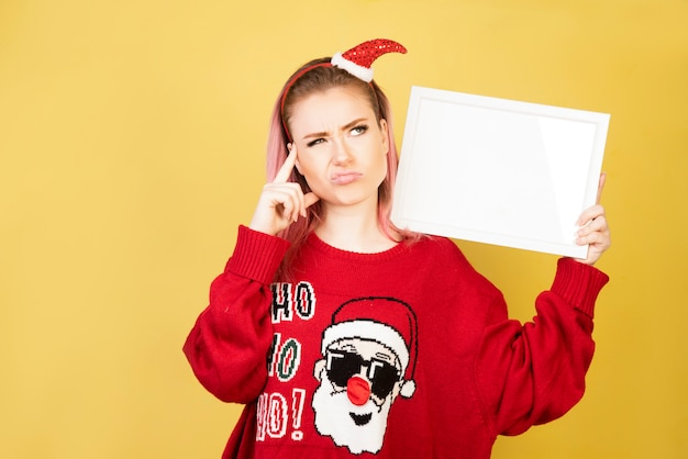 Thinking girl with red santa suit Free Photo