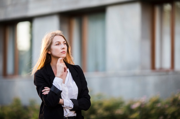 Thinking woman looking away Free Photo