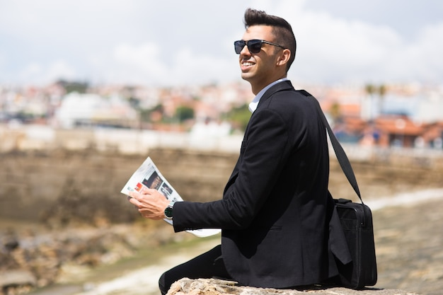 Thoughtful businessman dreaming of big goals Free Photo
