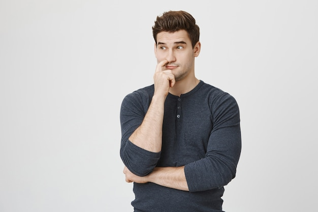 Thoughtful concerned man thinking, trying to find solution Free Photo