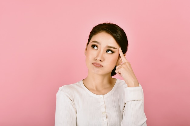 Thoughtful confused and dizzy asian woman, face expression feeling worry messy problems Premium Photo