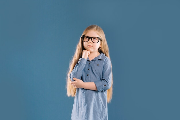 Thoughtful girl in glasses Free Photo