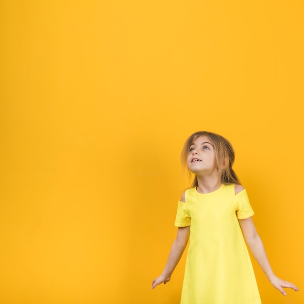 Thoughtful girl in yellow dress Free Photo