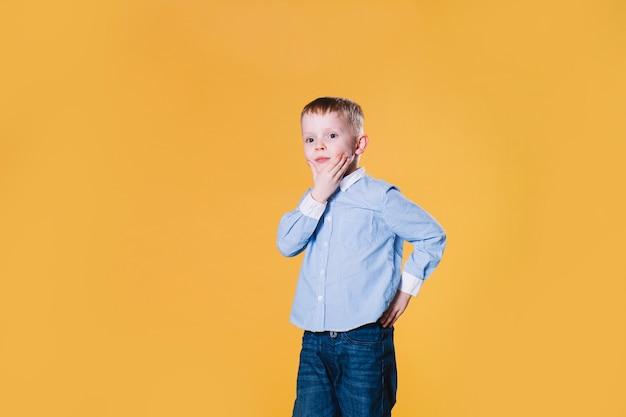 Thoughtful little boy Free Photo