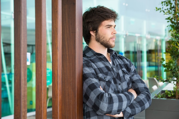 Thoughtful man standing outdoors with his arms crossed Free Photo
