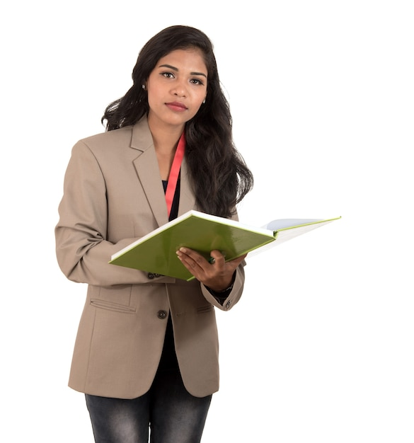 Thoughtful woman student, teacher or business lady holding books. isolated on white backgrounds Premium Photo