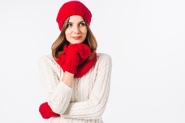 Thoughtful woman in warm clothes Free Photo