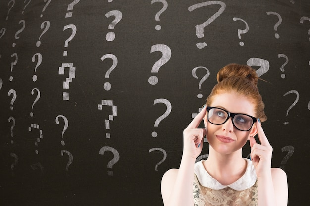 Thoughtful woman with question symbols behind Free Photo