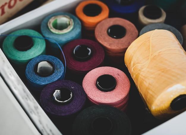 Thread cotton bobbins in box Premium Photo