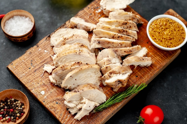 Premium Photo | Threaded pieces of grilled chicken fillet with spices,  tomatoes, mustard on a stone background
