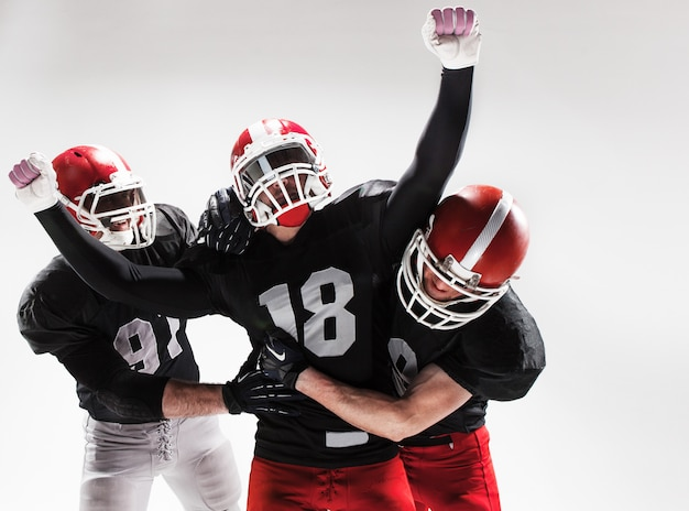 The three american football players posing on white space Free Photo