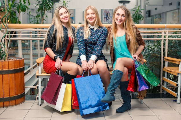 Three beautiful women with shopping bags Free Photo