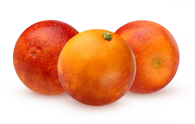Three bloody red oranges isolated Premium Photo