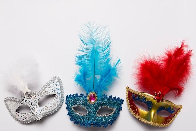 Three carnival masks on white Free Photo