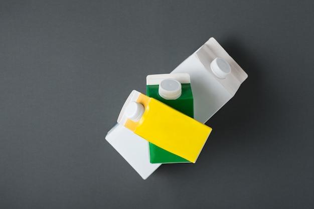 Three carton box or packaging of tetra pack on black Premium Photo
