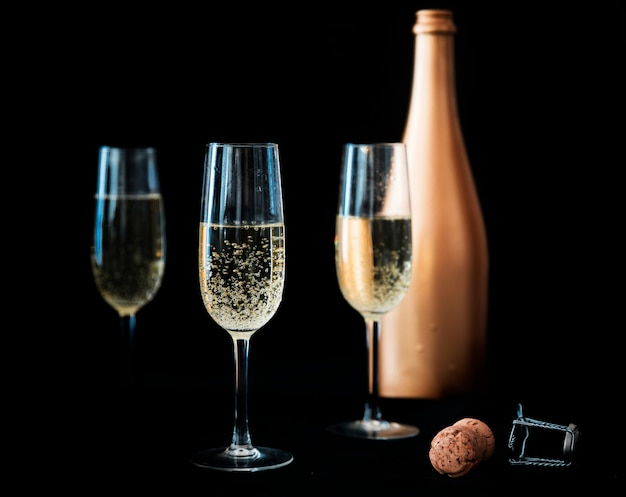 Three champagne glasses with bottle Free Photo