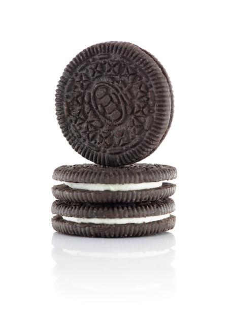 Three chocolate biscuits filled with cream Premium Photo