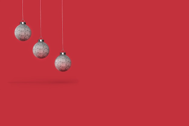 Three christmas balls with red background  wallpaper .  merry christmas concept Premium Photo