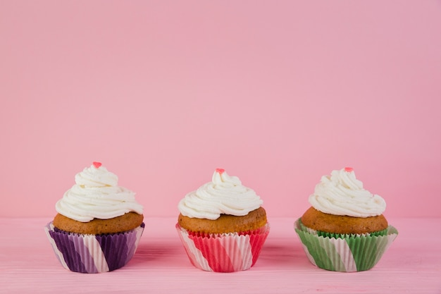 Three cupcakes for birthday with copyspace Free Photo
