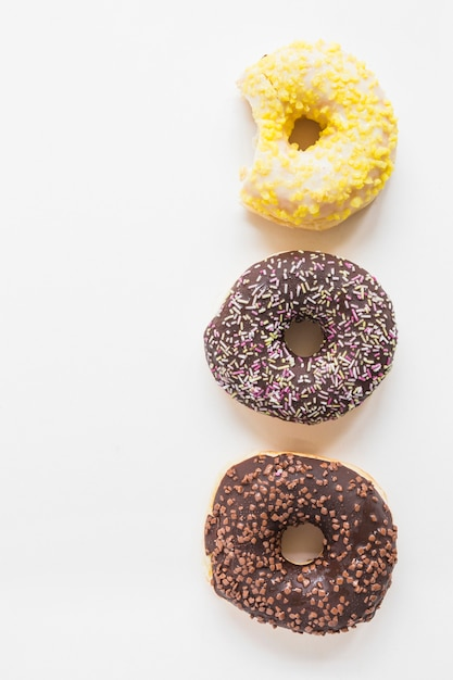 Three different donuts on white background Free Photo