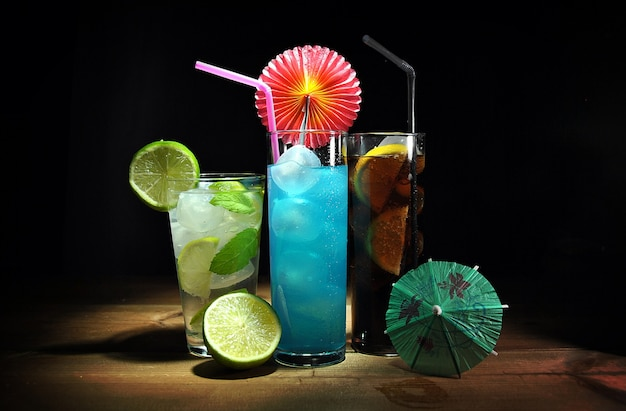 Three different, refreshing cocktails on wooden table Premium Photo