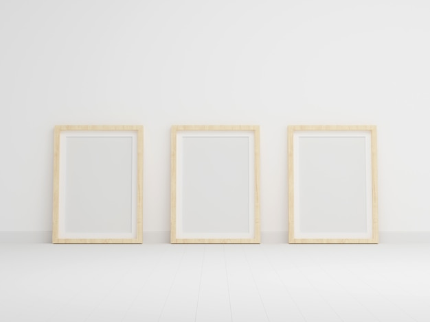 Three empty photo frame for mockup in empty white room Premium Photo