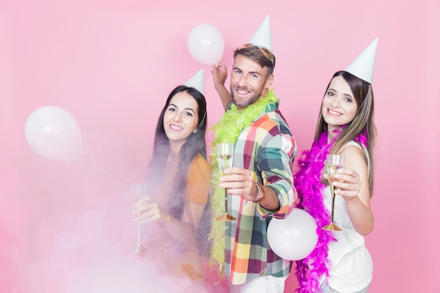 Three friends enjoying the champagne flute in the party Free Photo
