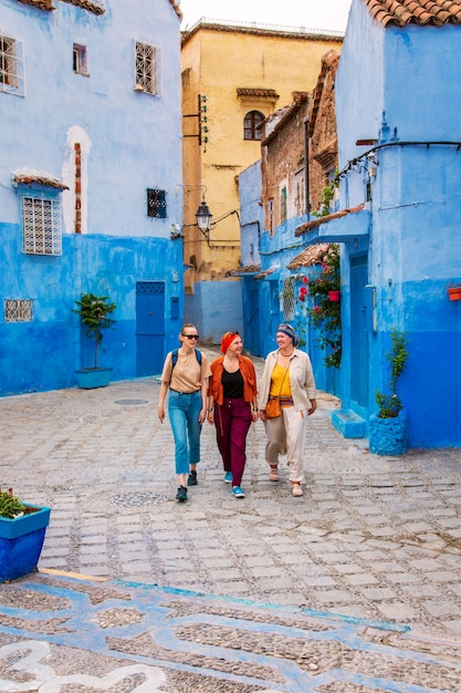 Three girls in the famous blue city. Premium Photo