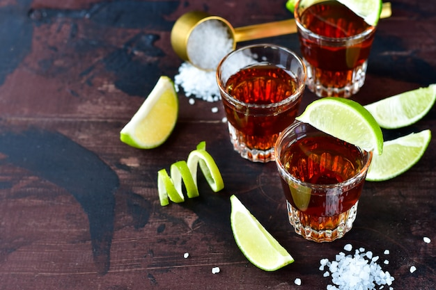 Three glasses of alcohol and lime and salt, a party at the bar, a menu for the bar Premium Photo