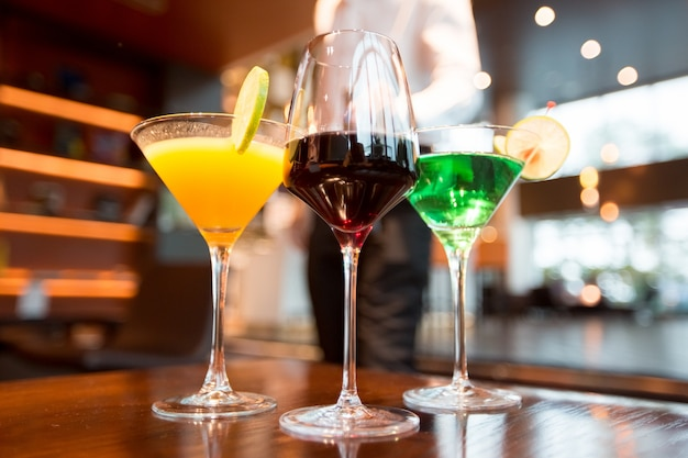 Three glasses of different alcoholic drinks in bar Free Photo