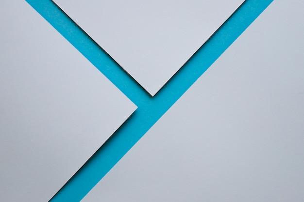 Tre carte da parati grigie sulla superficie blu Foto Gratuite