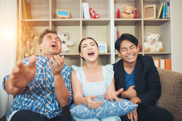 Three happy friends talking and big laughing after watching joke story Free Photo