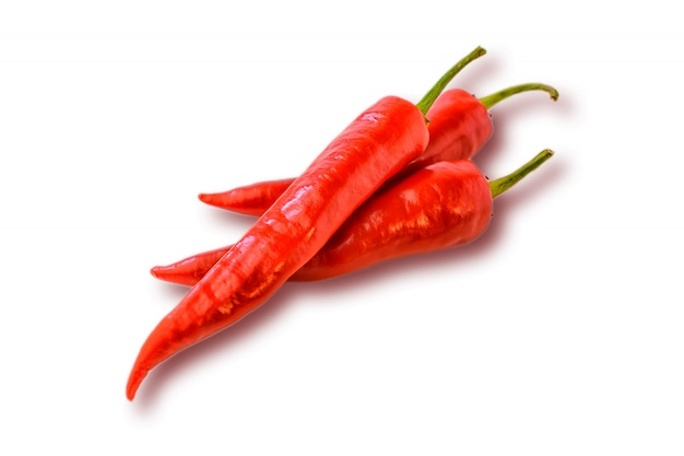 Three hot chilly pepper on the white Premium Photo