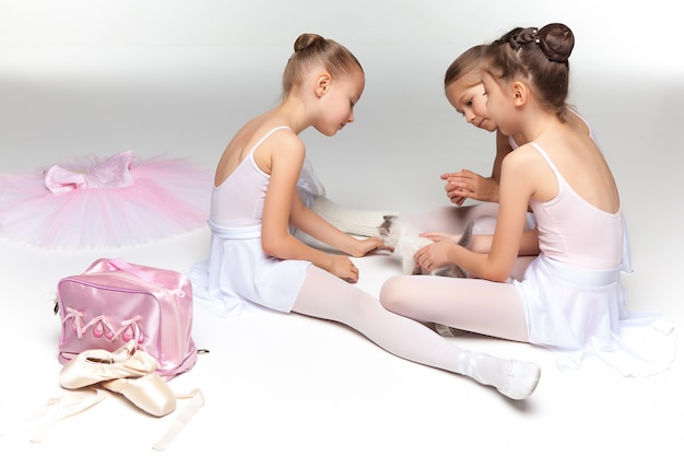 Three little ballet girls sitting and posing together Free Photo