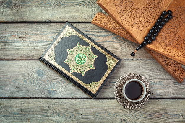Three months. islamic holy book quran with rosary beads. ramadan concept Premium Photo