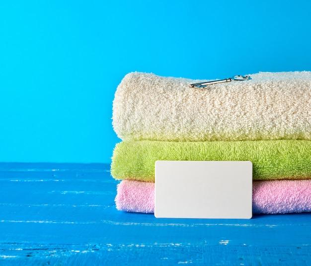 Three multi colored new terry bath towels folded Premium Photo
