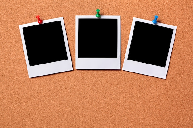 three polaroid photo prints on a cork notice board photo free download