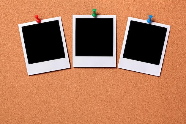 three polaroid po prints on a cork notice board po | free download