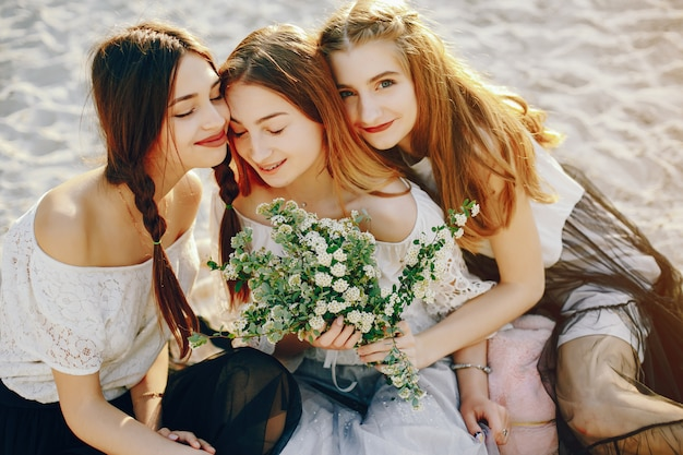 Three pretty girls in a summer park Free Photo