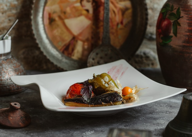 Three sisters domla with eggplant, tomato and green bell pepper. Free Photo