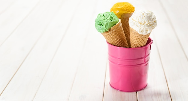 Three sorts of ice cream in waffel cones Premium Photo